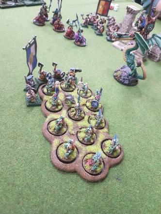 Dwarf elite make short work of some goblins while the wyvern waits his turn